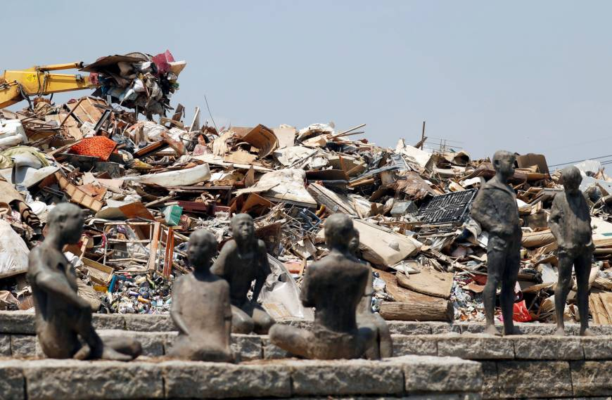 Debris from flooding in Western Japan is stacked up in a large heap